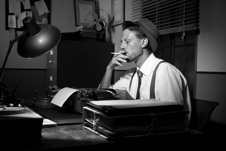 Image of male writer at typewriter